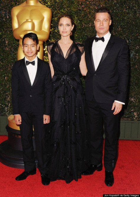 HOLLYWOOD, CA - NOVEMBER 16:  (R-L) Actor Brad Pitt, actress Angelina Jolie and son Maddox Jolie-Pitt arrive at The Board Of Governors Of The Academy Of Motion Picture Arts And Sciences' Governor Awards at Dolby Theatre on November 16, 2013 in Hollywood, California.  (Photo by Jon Kopaloff/FilmMagic)