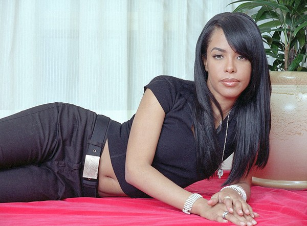 R&B singer and actress Aaliyah poses for a photo in New York on May 9, 2001. Aaliyah died Saturday, Aug. 25, 2001, when a small plane that was to carry her and eight others back to the United States crashed after takeoff in the Bahamas, authorities said. (AP Photo/Jim Cooper)