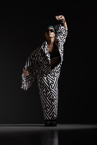 Photo courtesy of Kat Morgan White and black trench: KTZ Glasses: Cast Eyewear Shoes: KTZ Bracelet: KTZ Rings: Jennifer Jones